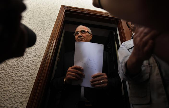 """Egyptian presidential candidate Ahmed Shafiq is seen before a press conference at his office in Cairo, Egypt, Saturday, May 26, 2012. Egyptian presidential candidate Ahmed Shafiq paid tribute Saturday to the """"glorious revolution"""" that toppled Hosni Mubarak, a dramatic turn-around for the former regime official who fought his way into the runoff elections by appealing to public disenchantment with last year's uprising. (AP Photo/Khalil Hamra)"""