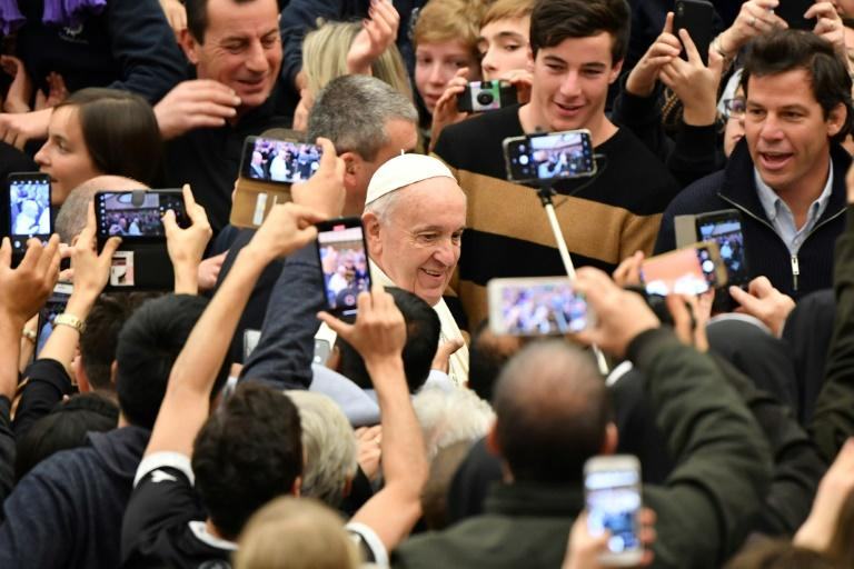 Pope Francis (C) is to unveil his stance on priestly marriage after a synod of Amazonian bishops recommended in October the priesthood be opened to married indigenous people