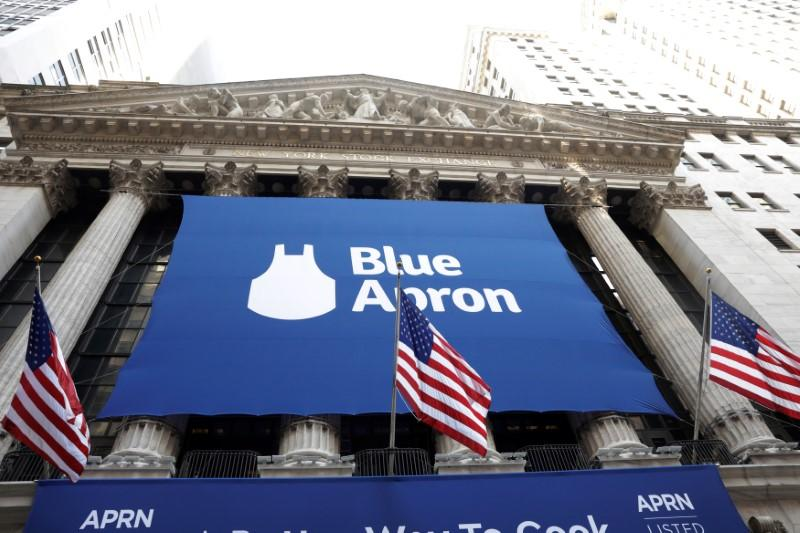 The logo of Blue Apron is shown on a large sign in front of the New York Stock Exchange before the company's IPO in New York