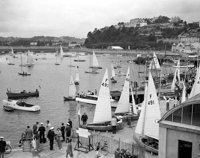 First day of the Olympic Games sailing races, shows yachts from France preparing to put to sea, in Torquay Harbour, England, Aug. 3, 1948. (AP Photo)