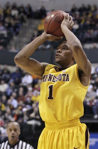 Minnesota guard Andre Hollins (1) takes a jump shot in the second half of an NCAA college basketball game against Minnesota at the first round of the Big Ten Conference tournament in Indianapolis, Thursday, March 8, 2012. (AP Photo/Michael Conroy)