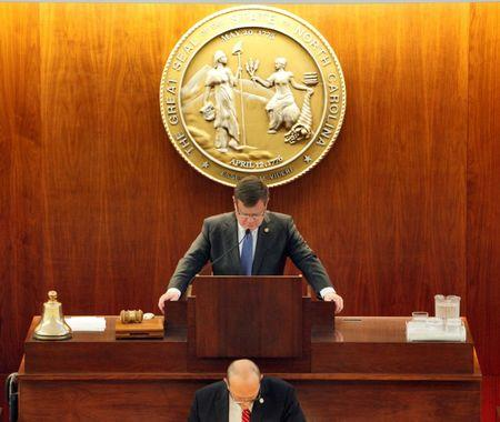 Speaker of the North Carolina House of Representatives Tim Moore (center) lowers his head in prayer as the chamber convenes to consider repealing the controversial HB2 law limiting bathroom access for transgender people in Raleigh, North Carolina, U.S. on December 21, 2016. REUTERS/Jonathan Drake
