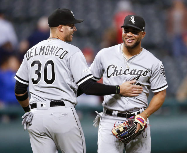 Chicago White Sox's Yoan Moncada (10) and Nicky Delmonico (30) celebrate a victory over the Cleveland Indians in a baseball game, Monday, May 6, 2019, in Cleveland. (AP Photo/Ron Schwane)