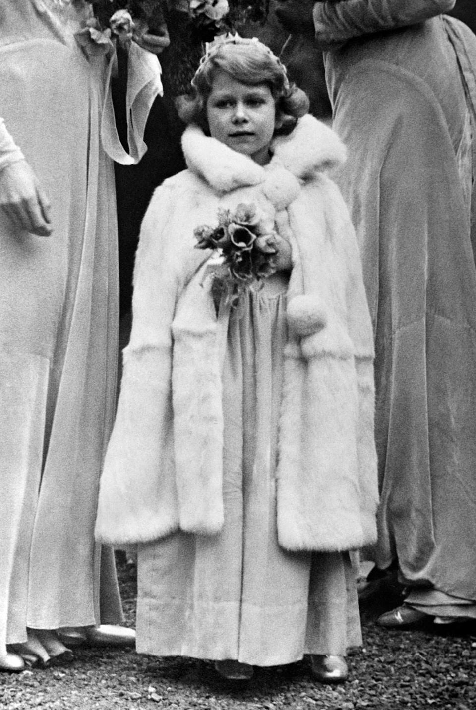 <p>Princess Elizabeth attends the wedding of Lady May Cambridge and Captain Henry Abel Smith (PA Archive) </p>