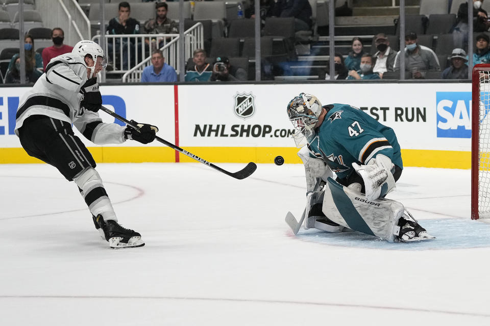 San Jose Sharks goaltender James Reimer (47) blocks a shot on goal by Los Angeles Kings left wing Austin Wagner (27) during the second period of an NHL hockey preseason game Tuesday, Sept. 28, 2021, in San Jose, Calif. (AP Photo/Tony Avelar)