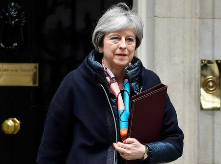 Britain's Prime Minister Theresa May leaves 10 Downing Street, in London