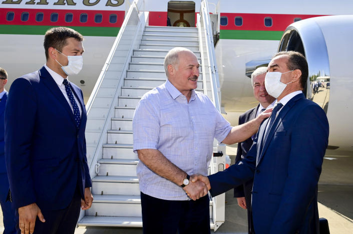 Belarusian President Alexander Lukashenko greets officials upon his arriving at the Black Sea resort of Sochi, Russia, Monday, Sept. 14, 2020. Belarus' authoritarian president, Lukashenko is visiting Sochi for talks with Russian President Vladimir Putin a day after an estimated 150,000 flooded the streets of the Belarusian capital, demanding Lukashenko's resignation. (Andrei Stasevich /BelTA Pool Photo via AP)