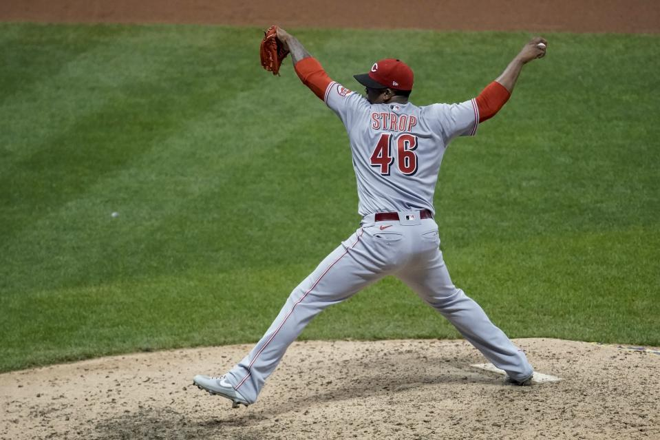 Cincinnati Reds relief pitcher Pedro Strop throws during the eighth inning of a baseball game against the Milwaukee Brewers Friday, Aug. 7, 2020, in Milwaukee. (AP Photo/Morry Gash)