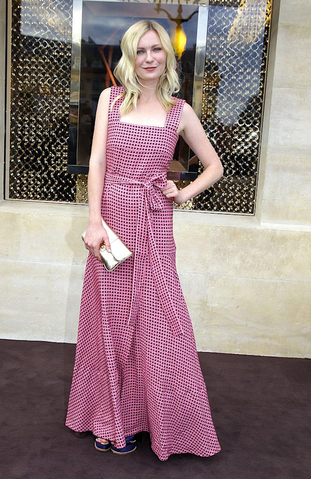 The majority of you will probably think this Louis Vuitton dress looks like a wonky apron, but we're going to have to disagree with you. The pink-and-purple maxi -- worn by Kirsten Dunst to a recent LV boutique opening -- is fun and unexpected, which makes it even more chic, as do those blue platform sandals. She just needs to keep working on that facial pose! (7/3/2012)