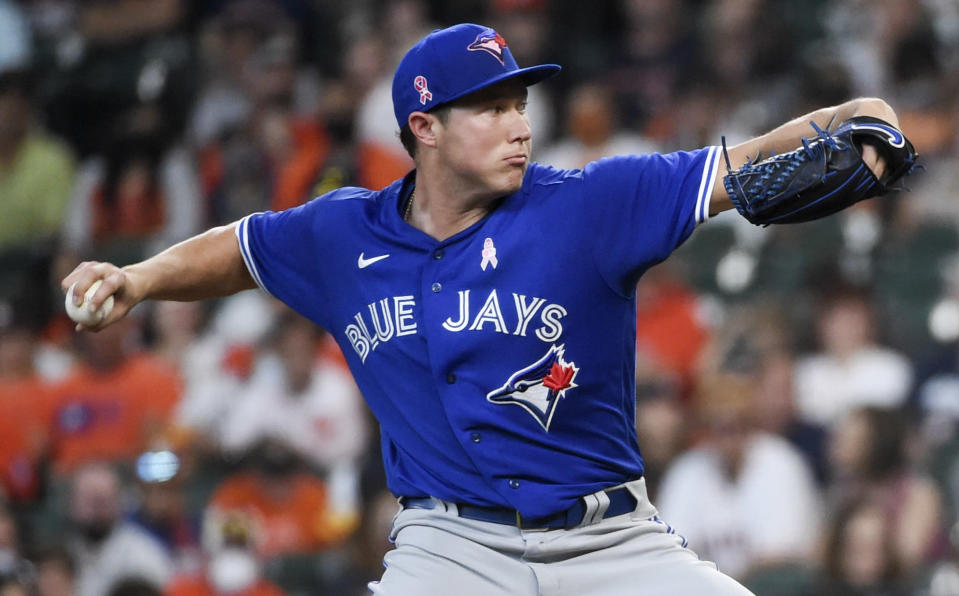 Toronto Blue Jays starting pitcher Nate Pearson delivers during the first inning of a baseball game against the Houston Astros, Sunday, May 9, 2021, in Houston. (AP Photo/Eric Christian Smith)
