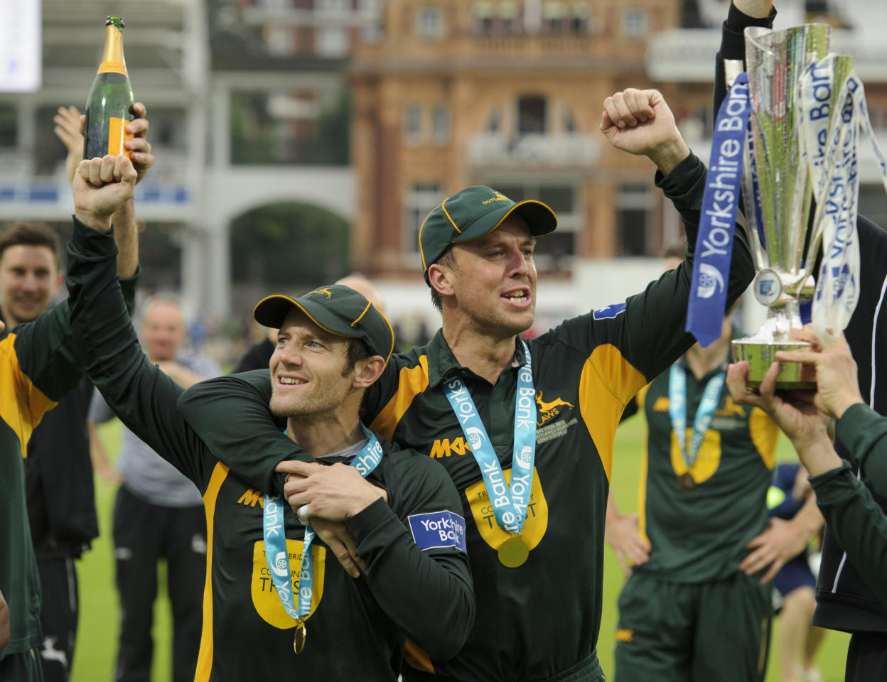 Nottinghamshire's Graeme Swann and Chris Read celebrate victory during the Yorkshire Bank Pro40 Final at Lord's Cricket Ground, London.