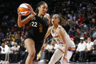 Las Vegas Aces forward A'ja Wilson (22) drives to the basket against Phoenix Mercury guard Skylar Diggins-Smith during the second half of Game 5 of a WNBA basketball playoff series Friday, Oct. 8, 2021, in Las Vegas. (AP Photo/Chase Stevens)
