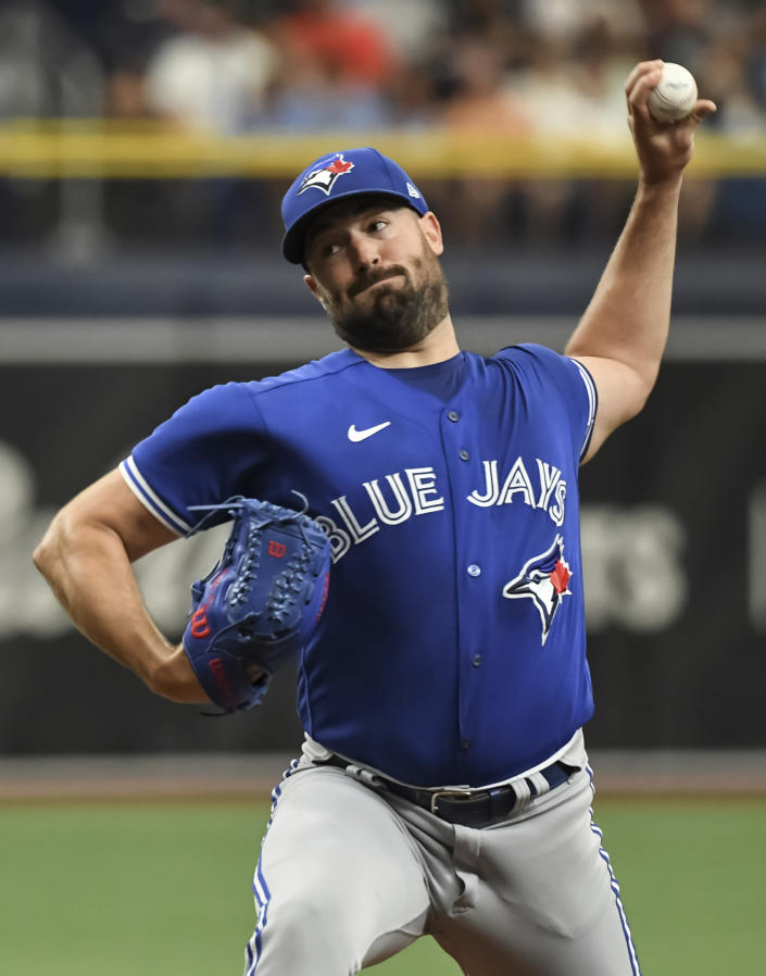 Toronto Blue Jays starter Robbie Ray pitches against the Tampa Bay Rays during the first inning of a baseball game Sunday, July 11, 2021, in St. Petersburg, Fla.(AP Photo/Steve Nesius)