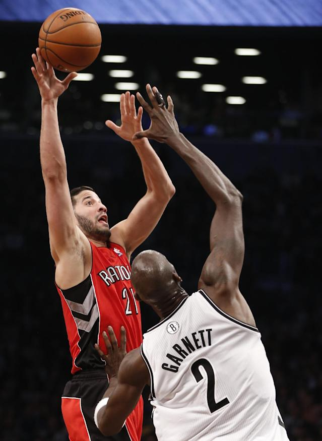 Toronto Raptors guard Greivis Vasquez (21) shoots over Brooklyn Nets center Kevin Garnett (2) in the first half of Game 4 of an NBA basketball first-round playoff series on Sunday, April 27, 2014, in New York. (AP Photo/Kathy Willens)