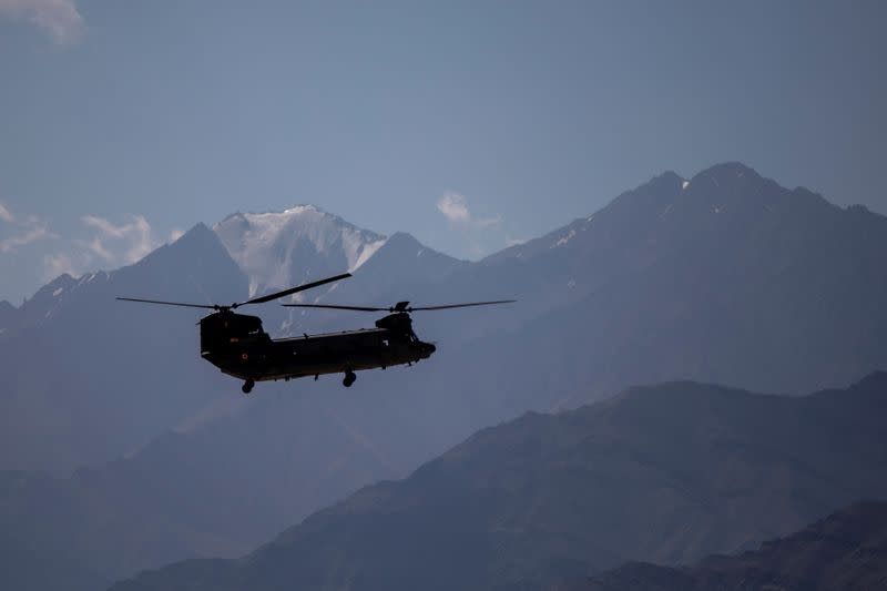 An Indian Air Force's Chinook helicopter carries supplies from a forward airbase in Leh