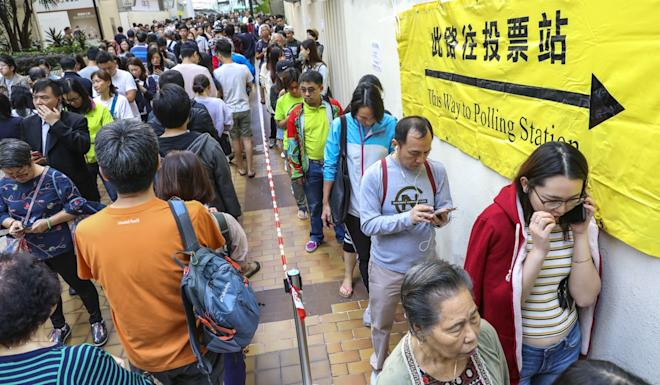 Voters queue to cast their ballots in the district council elections at a polling station at Aberdeen Sports Centre. Photo: May Tse