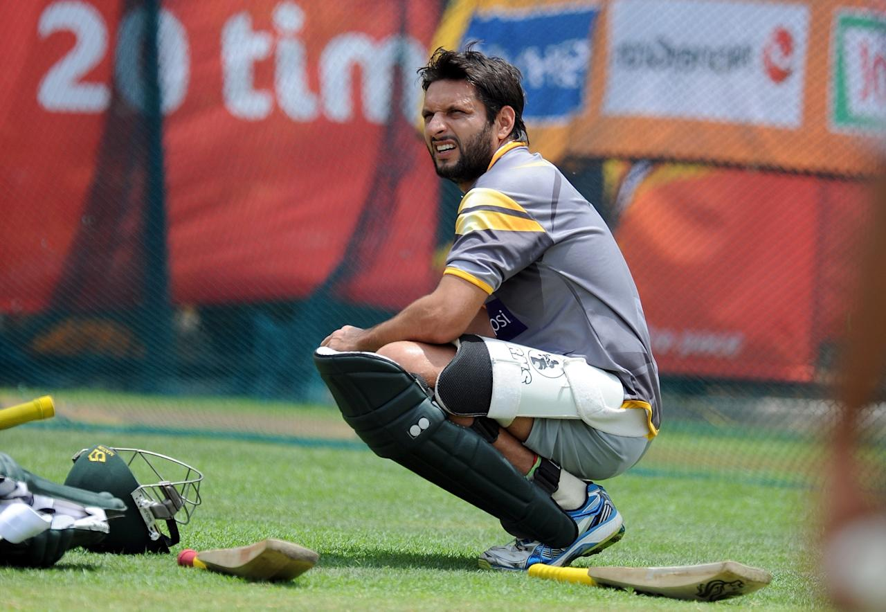 Pakistan cricketer Shahid Afridi rests after batting in the nets during a training session at the Pallekele International Cricket Stadium in Pallekele on September 24, 2012.   AFP PHOTO/ Prakash SINGH
