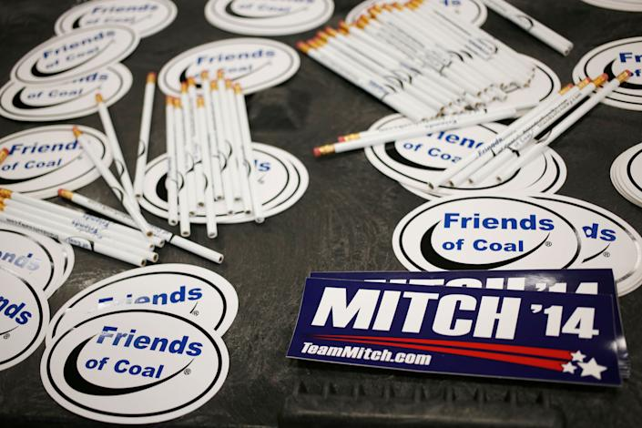 """Bumper stickers for Sen. Mitch McConnell sit on a table alongside """"Friends of Coal"""" advocacy stickers during a campaign stop in Lexington, Kentucky, on Oct. 31, 2014. (Photo: Luke Sharrett/Getty Images)"""