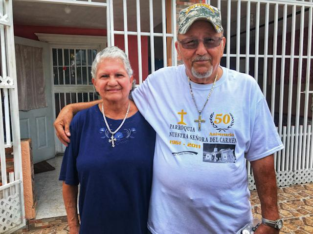 <p>Ramona and Santos Lopez Caraballo stand outside their home in Arecibo, P.R. on Oct. 10, 2017. The couple was completely cut off from communication for 15 days after Hurricane Maria hit Puerto Rico. (Photo: Caitlin Dickson/Yahoo News) </p>