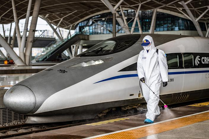 Image: A staff member sprays disinfectant at Wuhan Railway Station in Wuhan in China's central Hubei province (AFP - Getty Images)