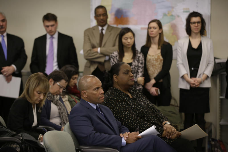 Massachusetts Gov. Deval Patrick listens intently as the state's Inspector General Glenn A. Cunha releases the findings of his investigation of the Hinton Drug Lab during a media availability at the offices of the Inspector General in Boston, Tuesday, March 4, 2014. The Hinton Drug Lab was shut down in 2012 in the wake of criminal acts by forensic chemist Annie Dookhan. (AP Photo/Stephan Savoia)