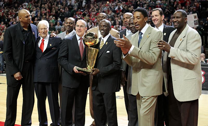 (L-R) Former players Scott Williams, assistant coach Johnny Bach, Dennis Hopson, John Paxson, Horace Grant, Craig Hodges, Stacey King, Michael Jordan, Scottie Pippen, Will Purdue and Cliff Levingston of the Chicago Bulls for the recognition ceremony of the Bulls 1st NBA Championship in 1991.
