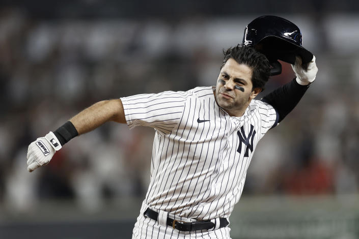 New York Yankees' Ryan LaMarre celebrates after driving in the winning run against the Philadelphia Phillies during the 10th inning of a baseball game Wednesday, July 21, 2021, in New York. The Yankees won 6-5. (AP Photo/Adam Hunger)