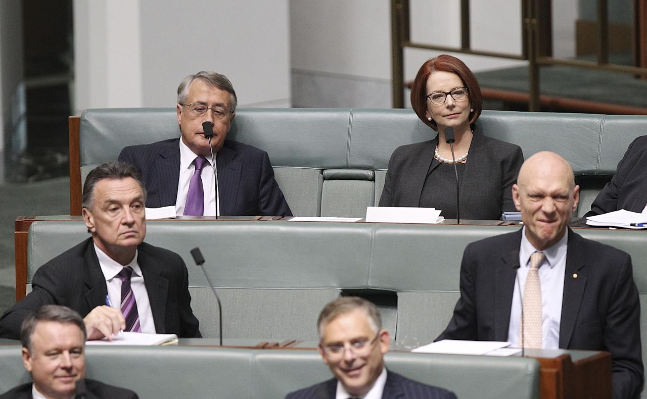 CANBERRA, AUSTRALIA - JUNE 27: Former PM Julia Gillard and former ministers Wayne Swan (Top L), Craig Emerson (Centre L), and Peter Garrett (R) sit on the back bench during House of Representatives question time on June 27, 2013 in Canberra, Australia. Kevin Rudd won an Australian Labor Party leadership ballot 57-45 last night, and will be sworn in this morning as Australian Prime Minister by Governor-General Quentin Bryce. Rudd was Prime Minister from 2007 to 2010 before he was dumped by his party for his deputy Julia Gillard. Gillard has announced that she will leave parliament and not contest her seat following her ballot loss. (Photo by Stefan Postles/Getty Images)