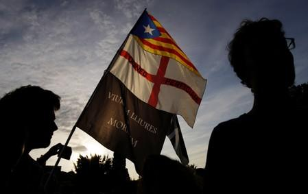 Catalan separatists march for independence amid splits on tactics
