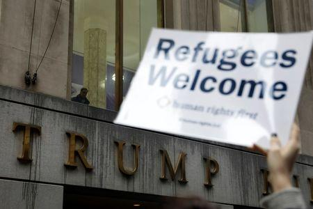 FILE PHOTO: Protesters gather outside the Trump Building at 40 Wall St. to take action against America's refugee ban in New York