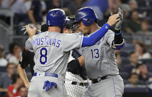 Kansas City Royals' Salvador Perez (13) celebrates with Mike Moustakas (8) after hitting a two-run home run against the New York Yankees during the sixth inning of a baseball game Thursday, July 26, 2018, in New York. (AP Photo/Frank Franklin II)