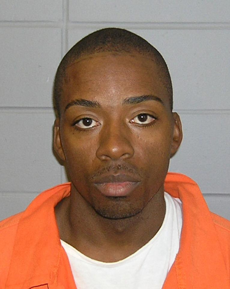 This undated photo provided by the FBI shows Jose Banks, one of two inmates who escaped from the Metropolitan Correctional Center in downtown Chicago Tuesday, Dec. 18, 2012. Chicago Police Sgt. Michael Lazarro says their disappearance was discovered at about 8:45 Tuesday morning. Lazarro says the pair used a rope or bed sheets to climb from the building. (AP Photo/FBI,HONS