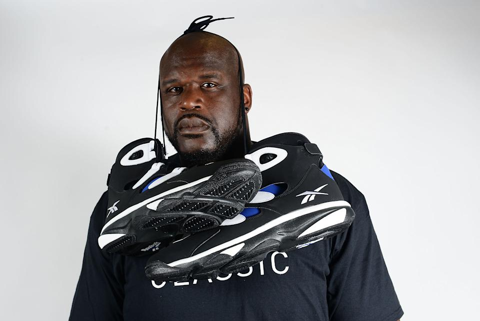 PHILADELPHIA, PA - JULY 09:  Former NBA basketball player Shaquille O'Neal poses with Reebok sneakers at the Reebok Classic Breakout at Philadelphia University on July 9, 2014 in Philadelphia, Pennsylvania.  (Photo by Lisa Lake/Getty Images for Reebok)