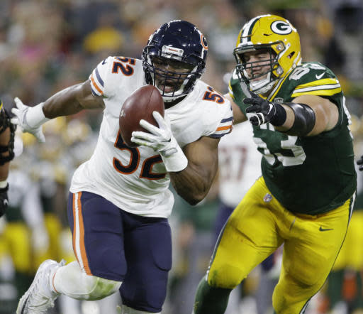 FILE - In this Sept. 9, 2018, file photo, Chicago Bears' Khalil Mack intercepts a pass and returns it for a touchdown during the first half of an NFL football game against the Green Bay Packers, in Green Bay, Wis. The beleaguered Arizona Cardinals offense must deal with Khalil Mack, who has two strip sacks and returned an interception for a touchdown in his two games since joining the Bears.(AP Photo/Jeffrey Phelps, File)