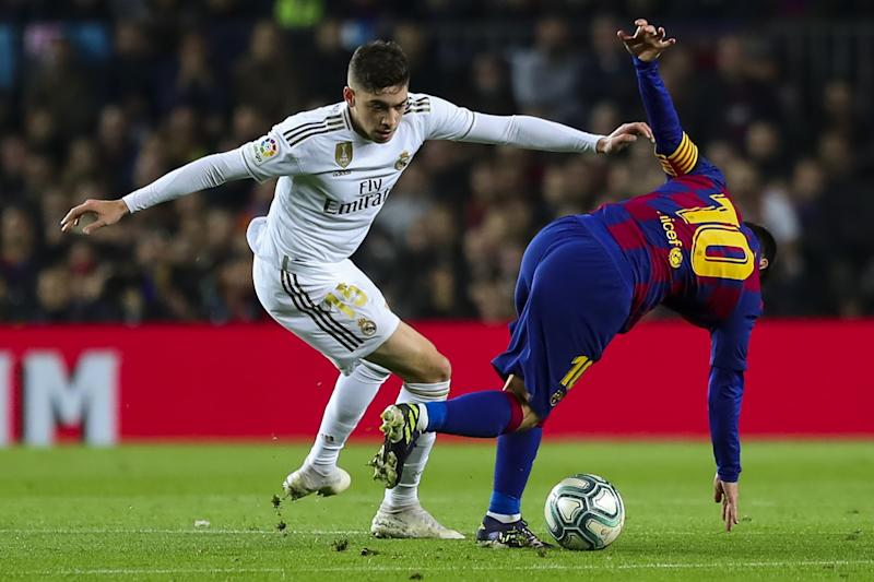 BARCELONA, SPAIN - DEC 18: Real Madrid's Uruguayan defender Federico Valverde (L) vies with Barcelona's Argentinian forward Lionel Messi (R) during Spanish El Clasico football match between FC Barcelona and Real Madrid at the Camp Nou stadium in Barcelona on December 18, 2019. (Photo by Adria Puig/Anadolu Agency via Getty Images)