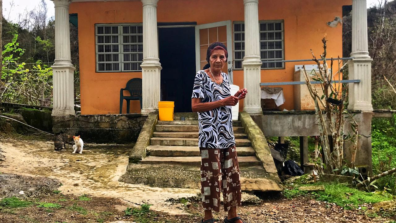 <p>Everista Alicea Gonzalez lives alone in Hatillo, Puerto Rico. Weeks after hurricane Maria, she was still without water, electricity, and communication. She said she had not seen anyone from FEMA, the National Guard or any other relief effort. (Photo: Caitlin Dickson/Yahoo News) </p>