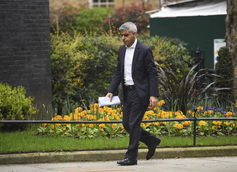 Mayor of London, Sadiq Khan arrives at 10 Downing Street, as the government is expected to publish an emergency coronavirus powers Bill, in London, Thursday March 19, 2020. For some people the new COVID-19 coronavirus causes only mild or moderate symptoms, but for some it can cause severe illness. (Kirsty O'Connor / PA via AP)