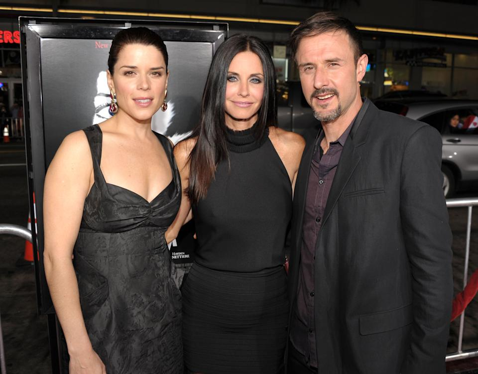 """HOLLYWOOD, CA - APRIL 11:  (L-R) Actors Neve Campbell, Courteney Cox and David Arquette arrive at the world premiere of The Weinstein Company's """"Scream 4"""" presented by AXE Shower at Grauman's Chinese Theatre on April 11, 2011 in Hollywood, California.  (Photo by John Shearer/WireImage)"""