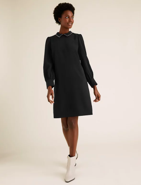 """<p><a class=""""link rapid-noclick-resp"""" href=""""https://go.redirectingat.com?id=127X1599956&url=https%3A%2F%2Fwww.marksandspencer.com%2Fcollared-knee-length-shift-dress%2Fp%2Fclp60479071&sref=https%3A%2F%2Fwww.redonline.co.uk%2Ffashion%2Fshopping%2Fg34625942%2Fmarks-and-spencer-womenswear-sale%2F"""" rel=""""nofollow noopener"""" target=""""_blank"""" data-ylk=""""slk:SHOP HERE"""">SHOP HERE</a> <strong>Was £45, Now £31.50</strong></p><p>The Collared Knee Length Shift Dress — which has featured several times on Holly Willoughby's Instagram — is a simple but glamorous ensemble ideal for work and after work.</p><p>The shift dress falls just above the knees, boasts long sleeves and a round neck with diamante detail collar.</p>"""
