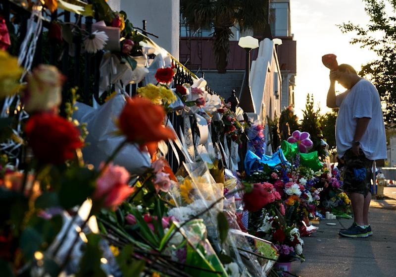 A man visits a memorial outside Emanuel AME Church on June 20, 2015 in Charleston, South Carolina