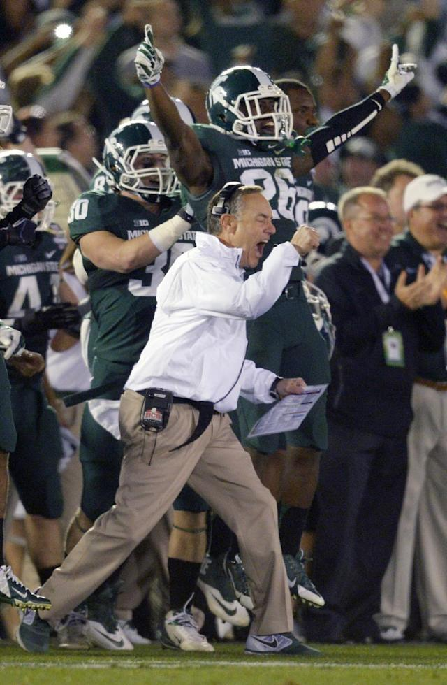 Michigan coach Mark Dantonio reacts to a turnover by Stanford during the second half of the Rose Bowl NCAA college football game Wednesday, Jan. 1, 2014, in Pasadena, Calif. Michigan State won 24-20. (AP Photo/Mark J. Terrill)