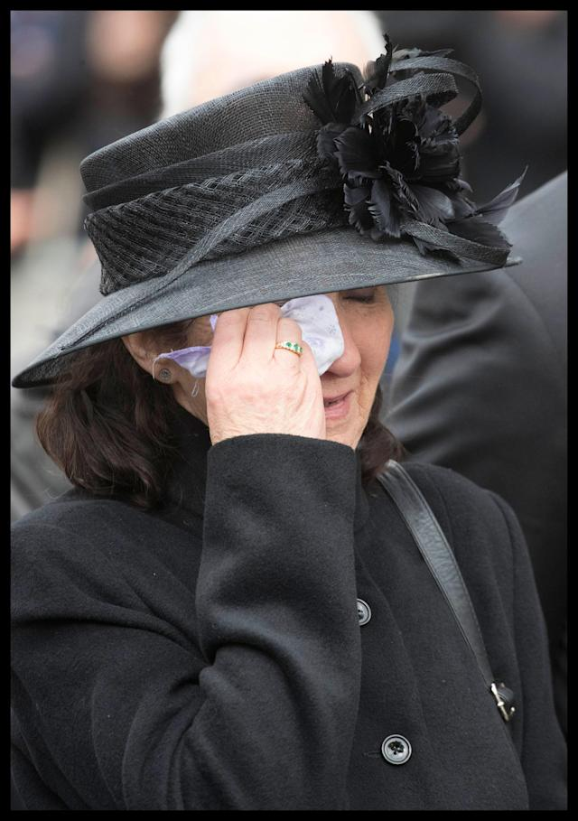 <p>Professor Stephen Hawking's first wife Jane breaks down in tears as his coffin leaves the University Church of St Mary the Great at the end of his funeral service in Cambridge, England on March 31, 2018. (Photo: Andrew Parsons/i-Images via ZUMA Press) </p>