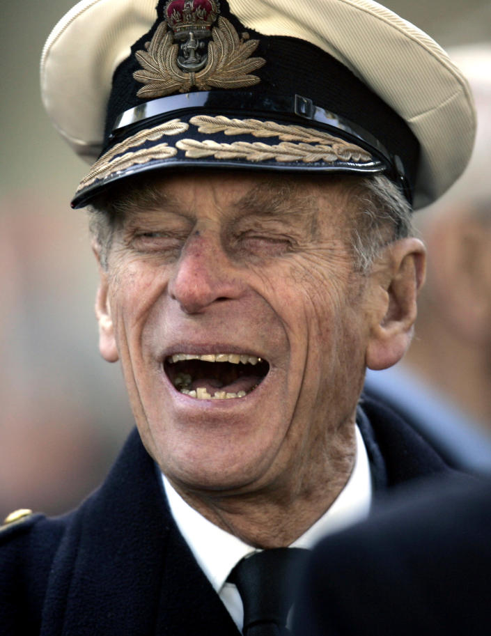 FILE - In this Nov. 9, 2006 file photo, Britain's Prince Philip shares a joke with a war veteran, following a ceremony for the Opening of the Field of Remembrance, on the grounds of the Westminster Abbey, in central London. Buckingham Palace says Prince Philip, husband of Queen Elizabeth II, has died aged 99. (AP Photo/Lefteris Pitarakis, File)