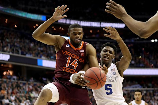 <p>P.J. Horne #14 of the Virginia Tech Hokies looks for the rebound against RJ Barrett #5 of the Duke Blue Devils during the first half in the East Regional game of the 2019 NCAA Men's Basketball Tournament at Capital One Arena on March 29, 2019 in Washington, DC. (Photo by Patrick Smith/Getty Images) </p>
