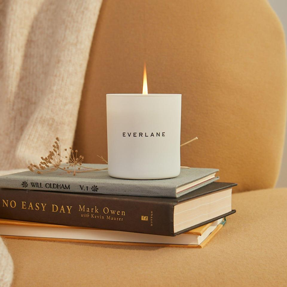 """<p><strong>everlane</strong></p><p>everlane.com</p><p><a href=""""https://go.redirectingat.com?id=74968X1596630&url=https%3A%2F%2Fwww.everlane.com%2Fproducts%2Funisex-candle-white&sref=https%3A%2F%2Fwww.womenshealthmag.com%2Fstyle%2Fg35904128%2Feverlane-spring-sale-restock-2021%2F"""" rel=""""nofollow noopener"""" target=""""_blank"""" data-ylk=""""slk:Shop Now"""" class=""""link rapid-noclick-resp"""">Shop Now</a></p><p><strong><del>$35</del> $24 (31% off) </strong></p><p>Want to increase your home's cozy vibes? Between the welcoming glow and nuanced blend of cedar, spicy patchouli, and warm vetiver, lighting this universally-loved candle will undoubtedly become your daily spring ritual.</p>"""