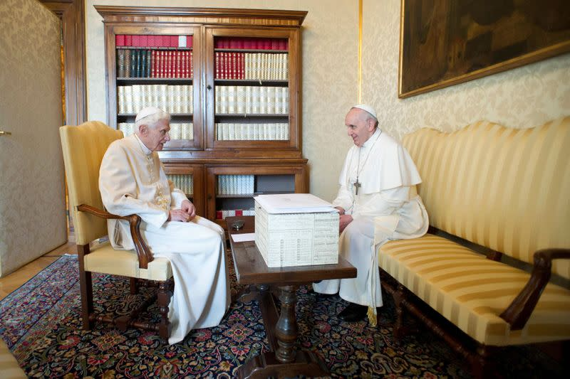 FILE PHOTO: Pope Francis talks with Pope Emeritus Benedict XVI at the Castel Gandolfo summer residence, south of Rome