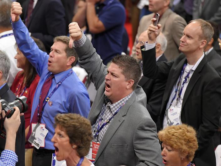 Delegates react as some call for a roll call vote on the adoption of the rules during the opening day of the Republican National Convention in Cleveland, Monday, July 18, 2016. (Photo: Mark J. Terrill/APl)