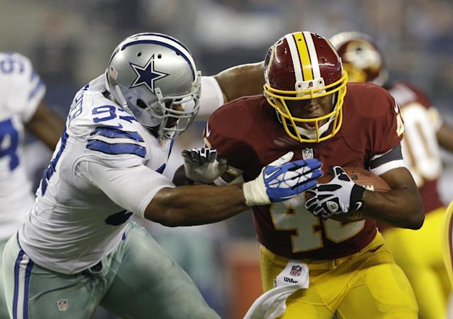 Dallas Cowboys defensive end DeMarcus Ware (94) chases down Washington Redskins running back Alfred Morris (46) in the first half of an NFL football game, Sunday, Oct. 13, 2013, in Arlington, Texas. (AP Photo/LM Otero)