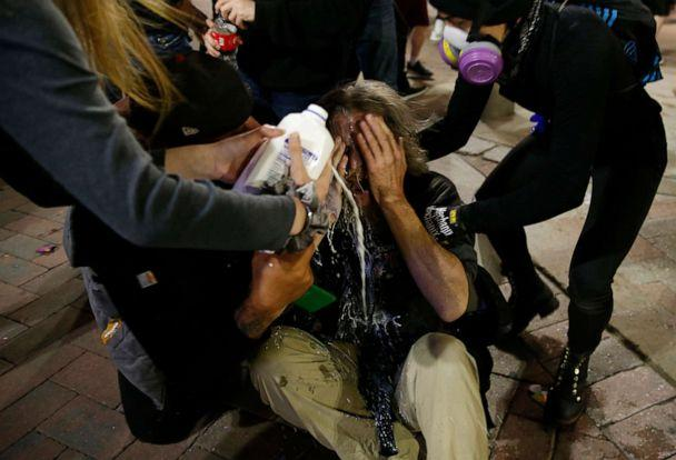 PHOTO: A man who was pepper sprayed by police has milk poured on his face in Downtown Crossing after a march held to protest the death of George Floyd in Boston, May 31, 2020. (Jessica Rinaldi/The Boston Globe via Getty Images, FILE)