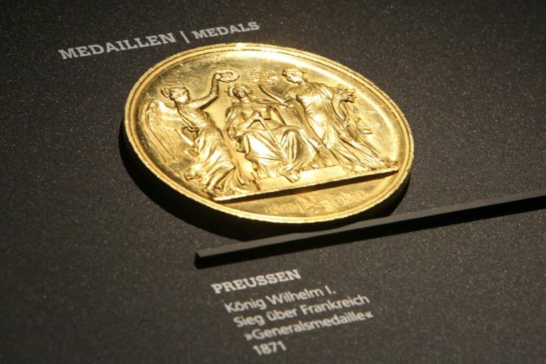 Out with the new, in with the gold: an 1871 medal on display at the Money Museum